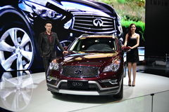 Female and Male Fashion Model on Infiniti QX50 SUV Stock Images