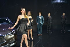 Female and Male Fashion Models in the booth of Infiniti Stock Photos