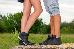 Female and male feet are , the concept of the relationship royalty free stock images