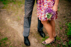 Female and male feet on grass Stock Image