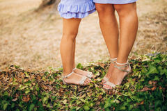 Female and male feet on grass Stock Photo