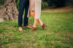 Female and male feet on grass Royalty Free Stock Photography