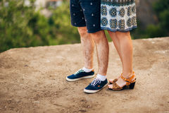 Female and male feet on the pavement Royalty Free Stock Image