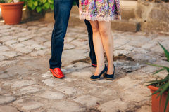 Female and male feet on the pavement Stock Photography