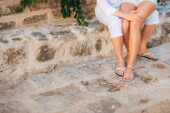 Female and male feet on the pavement Stock Image