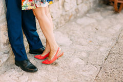 Female and male feet on the pavement Royalty Free Stock Photos