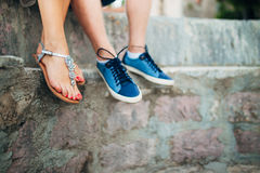 Female and male feet on the rocks Stock Photo