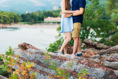 Female and male feet on the rocks Stock Photos