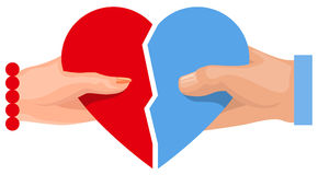 Female and male hand holding heart symbol of love. Two half heart Stock Photo