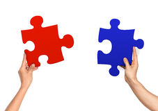 Female and male hands holding jigsaw Stock Images