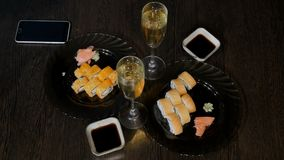 Female and male hands take rolls, sushi. stock footage