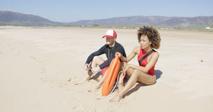Female and male lifeguards patrolling beach. Female and male lifeguards with rescue orange float patrolling beach. Tarifa beach. Provincia Cadiz. Spain Royalty Free Stock Images