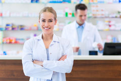 Female and male pharmacists Royalty Free Stock Photo
