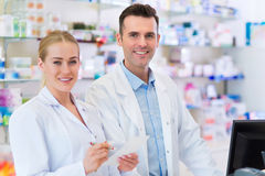 Female and male pharmacists Stock Image
