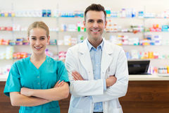 Female and male pharmacists. In pharmacy Royalty Free Stock Photos