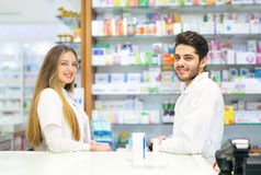 Female and male pharmacists in pharmacy stock photo