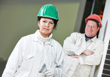 Female and male plasterers portrait Royalty Free Stock Image