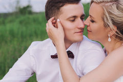 Female and male portrait. Lady and guy outdoors.Wedding couple in love, close-up portrait of young and happy bride and groom at we Royalty Free Stock Photography