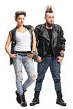 Female and male punker. Full length portrait of a female and a male punker looking at the camera isolated on white background stock images