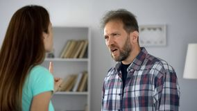 Female and male quarreling, problems in family couple relationship, conflict. Stock photo royalty free stock photo