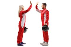 Female and a male racer high-fiving each other Stock Images