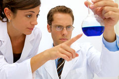 Female and Male Scientists Stock Photos