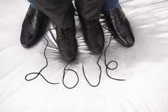 Female and male shoes with word love on the silver background. Love concept Stock Photos