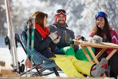 Female and male on skiing enjoy in cafe royalty free stock photo