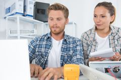 Female and male technician working with transistor in laboratory. Technician Royalty Free Stock Photo