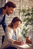 Female and male working in office stock photos