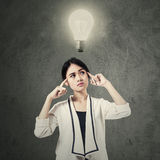 Female manage with lightbulb over head Royalty Free Stock Photography