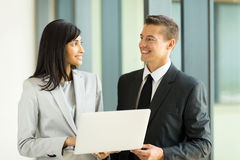 Female manager businessman. Professional indian female manager with businessman working on laptop Stock Photo