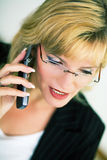 Female manager with cellphone Royalty Free Stock Photos