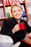 Female manager with coffee cup Stock Photo
