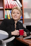 Female manager with coffee cup Stock Images