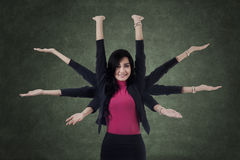 Female manager with eight hands Royalty Free Stock Photos