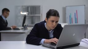 Female manager fighting with sleeping desire at workplace in front of laptop. Stock footage stock footage