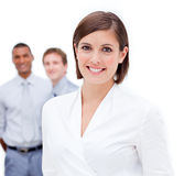 Female manager in front of her team Stock Photo