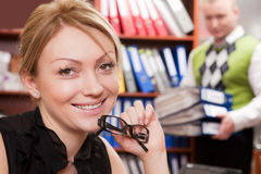 Female manager with glasses. Smiling female manager with glasses thinks about the prosperous business Stock Photography