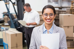 Female manager holding files during busy period Stock Image