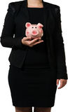 Female manager holding a piggy bank Stock Images