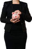 Female manager holding a piggy bank Stock Photo