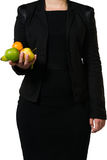 Female manager holding some easy found fruit Royalty Free Stock Photo