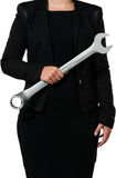 Female manager holding wrench Royalty Free Stock Images