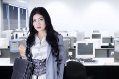 Female manager holds briefcase in office Stock Photography