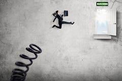 Female manager jumping toward success door Stock Photos