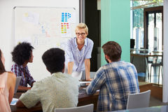 Female Manager Leading Brainstorming Meeting In Office Stock Photos