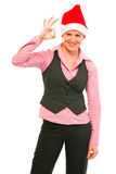 Female manager in Santa Hat showing ok gesture Royalty Free Stock Images