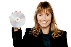 Female manager showing compact disc Stock Images