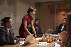 Female manager standing to address team at business meeting royalty free stock photo